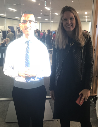 Frances Valintine of TechFutures Lab with the hologram of Watercare CEO Raveen Jaduram during the Digital Day