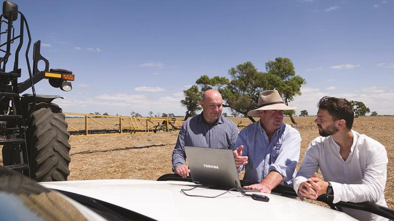 CBA's Corey Barlow-Jensen, farmer Andrew Johnson and CBA Emerging Technology manager Andrew Despi.