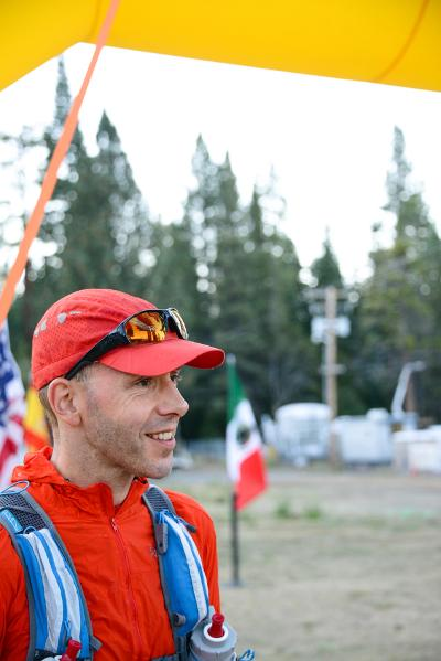 Andre Blumberg at the finish line of the Tahoe 200, a 200-mile endurance run around the largest alpine lake in North America. Image credit: Patchanida Pongsubkarun