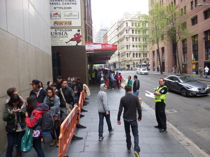 People waiting around the corner.